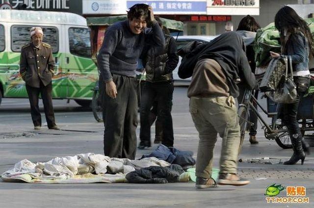 Попрошайка в Китае (5 фото)